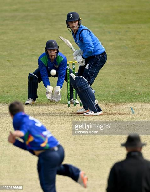 Dublin , Ireland - 1 May 2021; Batsman Jack Tector of Leinster Lightning and North West Wariors wicketkeeper Stephen Doheny watch a delivery from...