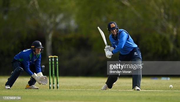Dublin , Ireland - 1 May 2021; George Dockrell of Leinster Lightning plays a shot watched by North West Warriors wicketkeeper Stephen Doheny during...