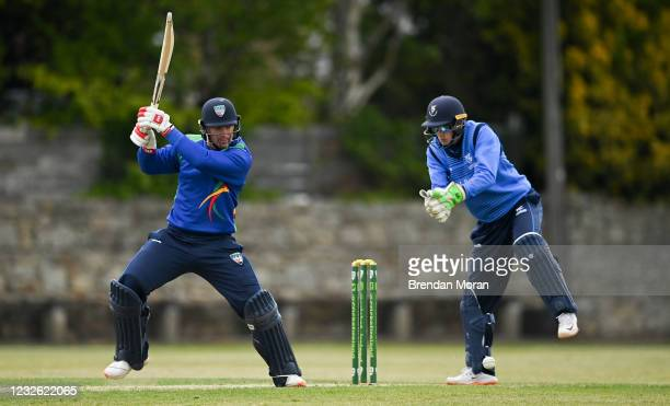 Dublin , Ireland - 1 May 2021; Graham Hume of North West Warriors playes a shot past Leinster Lightning wicketkeeper Lorcan Tucker during the...