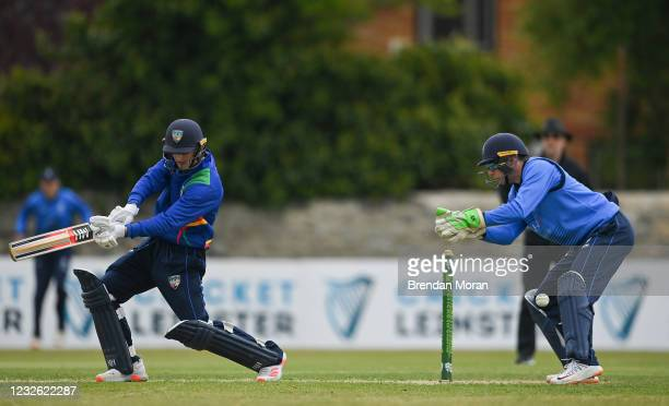 Dublin , Ireland - 1 May 2021; Graham Kennedy of North West Warriors plays a shot past Leinster Lightning wicket keeper Lorcan Tucker during the...