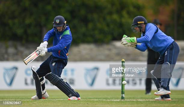 Dublin , Ireland - 1 May 2021; Graham Kennedy of North West Warriors plays a shot past Leinster Lightning wicketkeeper Lorcan Tucker during the...
