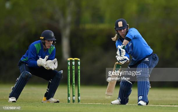 Dublin , Ireland - 1 May 2021; Jamie Grassi of Leinster Lightning plays a shot watched by North West Warriors wicketkeeper Stephen Doheny during the...