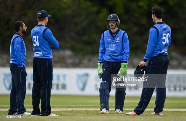 Dublin , Ireland - 1 May 2021; Leinster Lightning wicketkeeper Lorcan Tucker in discussion with bowlers, from left, Simi Singh, Jack Tector and...