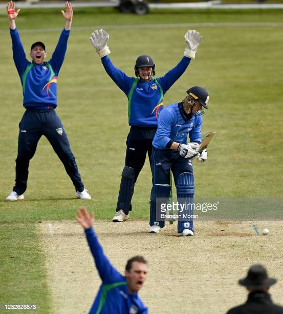 Dublin , Ireland - 1 May 2021; North West Warriors wicketkeeper Stephen Doheny and team-mate Shane Getkate and bowler Andy McBrine appeal for the...