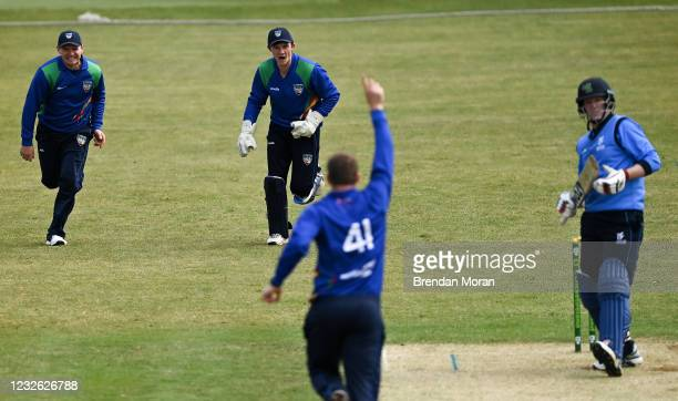 Dublin , Ireland - 1 May 2021; North West Warriors wicketkeeper Stephen Doheny, centre, celebrates with William Porterfield, left, and bowler Graham...