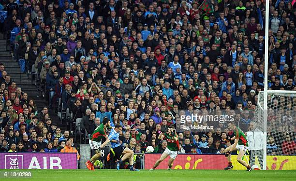 Dublin , Ireland - 1 October 2016; Cormac Costello of Dublin, under pressure from Mayo players Kevin McLoughlin, left, Brendan Harrison and Diarmuid...