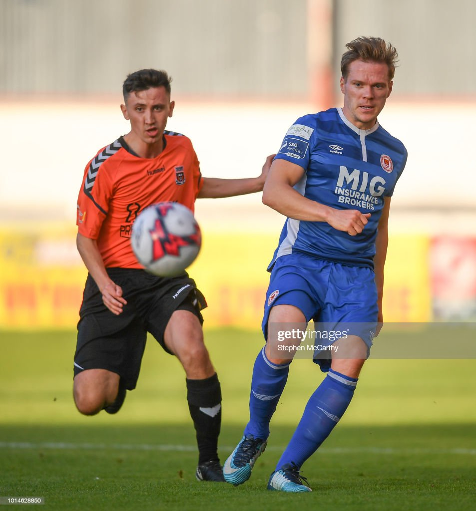 Dublin , Ireland - 10 August 2018; Simon Madden of St Patrick's Athletic in action against Leon Fahey Byrne of Inchicore Athletic during the Irish Daily Mail FAI Cup First Round match between Inchicore Athletic and St Patrick's Athletic at Richmond Park in Inchicore, Dublin.
