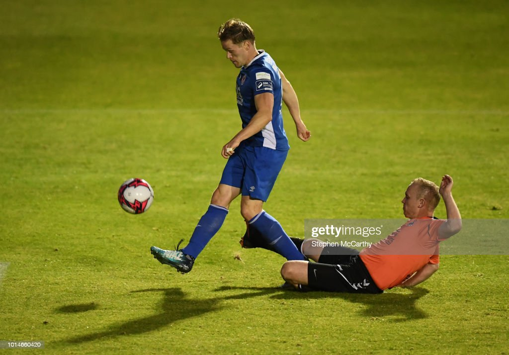 Dublin , Ireland - 10 August 2018; Simon Madden of St Patrick's Athletic in action against Derek Roche of Inchicore Athletic during the Irish Daily Mail FAI Cup First Round match between Inchicore Athletic and St Patrick's Athletic at Richmond Park in Inchicore, Dublin.