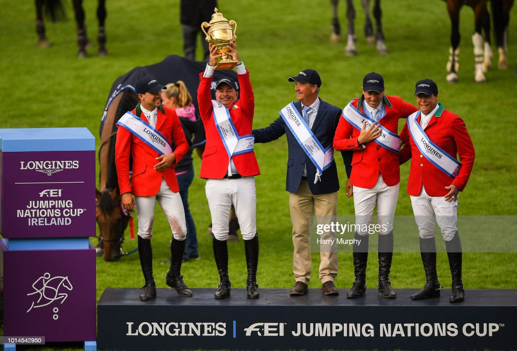 Dublin , Ireland - 10 August 2018; The Mexico team, from left, Eugenio Garza Perez, Enrique Gonzalez, Chef d'Equipe Stanny van Paesschen, Patricio Pasquel and Federico Fernandez celebrate with the Aga Khan Cup following the Longines FEI Jumping Nations Cup of Ireland during the StenaLine Dublin Horse Show at the RDS Arena in Dublin.