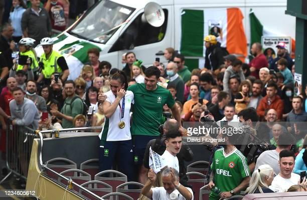 Dublin , Ireland - 10 August 2021; An emotional Team Ireland women's lightweight gold medallist Kellie Harrington and Emmet Brennan pass through...