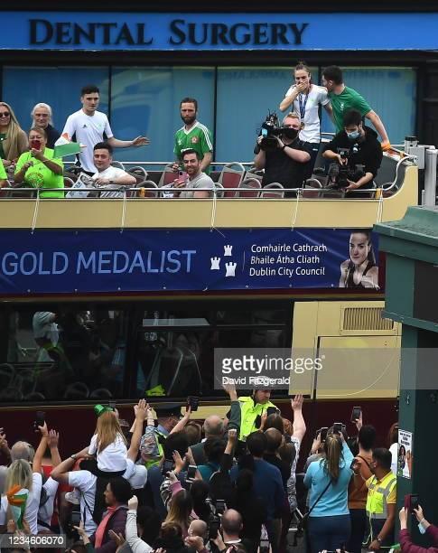 Dublin , Ireland - 10 August 2021; An emotional Team Ireland women's lightweight gold medallist Kellie Harrington and Emmet Brennan as the bus turns...