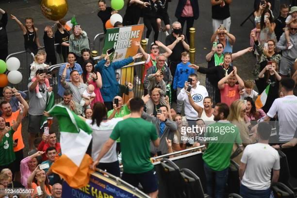 Dublin , Ireland - 10 August 2021; Supporters cheer on as Team Ireland women's lightweight gold medallist Kellie Harrington and Emmet Brennan pass...