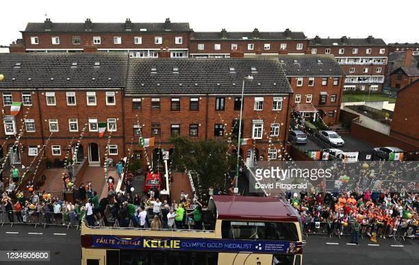 Dublin , Ireland - 10 August 2021; Team Ireland women's lightweight gold medallist Kellie Harrington and Emmet Brennan pass through Portland Row in...