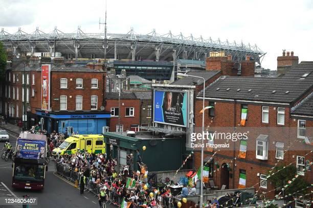 Dublin , Ireland - 10 August 2021; The bus turns onto Portland Row in Dublin carrying Team Ireland women's lightweight gold medallist Kellie...