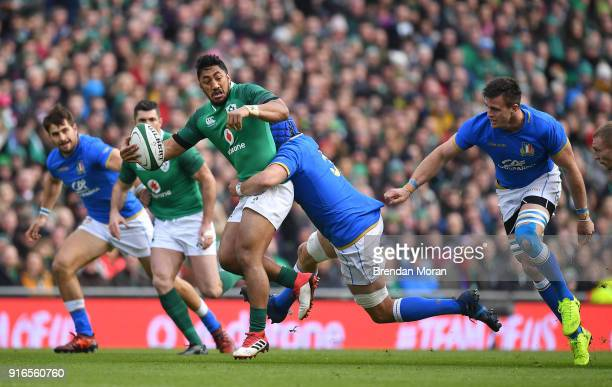 Dublin Ireland 10 February 2018 Bundee Aki of Ireland is tackled by Dean Budd of Italy during the Six Nations Rugby Championship match between...