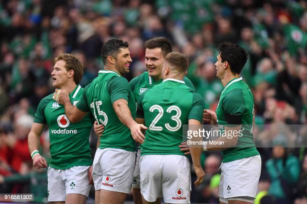 Dublin Ireland 10 February 2018 Jacob Stockdale of Ireland celebrates scoring his sides 6th try with teammates Kieran Marmion left Rob Kearney Jordan...