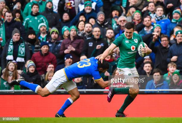 Dublin Ireland 10 February 2018 Jacob Stockdale of Ireland evades the tackle of Jayden Hayward of Italy on his way to scoring his side's eighth try...