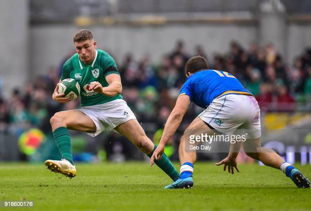 Dublin Ireland 10 February 2018 Jordan Larmour of Ireland evades the tackle of Tommaso Castello of Italy during the Six Nations Rugby Championship...