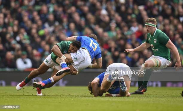 Dublin Ireland 10 February 2018 Matteo Minozzi of Italy is tackled by Bundee Aki of Ireland during the Six Nations Rugby Championship match between...