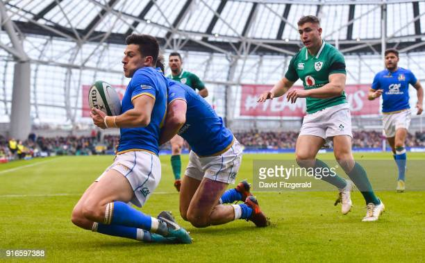Dublin Ireland 10 February 2018 Mattia Bellini of Italy slides in to prevent Jordan Larmour of Ireland running onto a kicked through ball at the line...