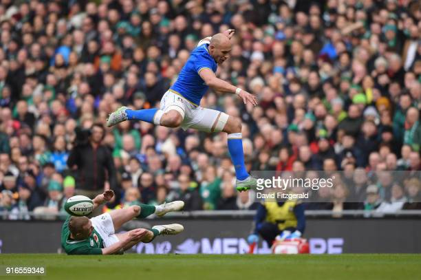 Dublin Ireland 10 February 2018 Sergio Parisse of Italy is tackled by Keith Earls of Ireland during the Six Nations Rugby Championship match between...