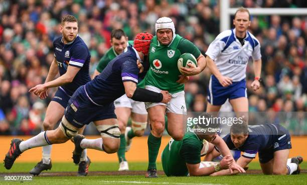 Dublin Ireland 10 March 2018 Rory Best of Ireland is tackled by Grant Gilchrist of Scotland during the NatWest Six Nations Rugby Championship match...