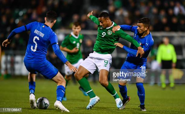 Dublin Ireland 10 October 2019 Adam Idah of Republic of Ireland in action against Alessandro Bastoni left and Enrico Del Prato of Italy during the...