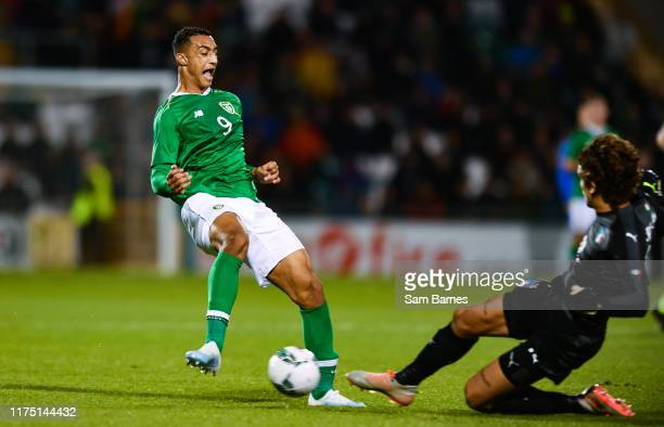 Dublin Ireland 10 October 2019 Adam Idah of Republic of Ireland in action against Marco Carnesecchi of Italy during the UEFA European U21...
