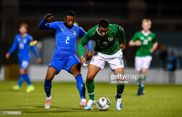 Dublin , Ireland - 10 October 2019; Adam Idah of Republic of Ireland in action against Claud Adjapong of Italy during the UEFA European U21...