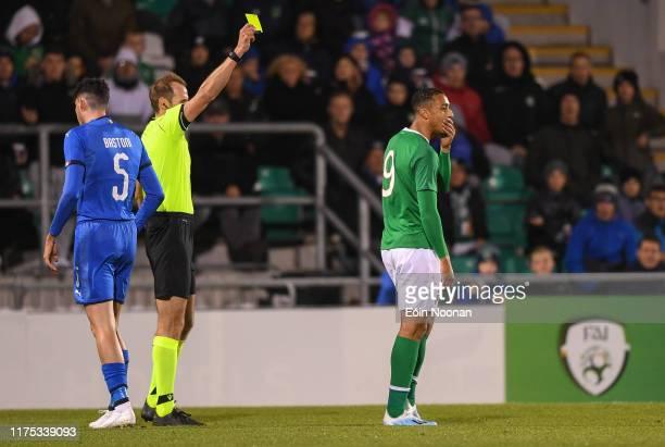 Dublin , Ireland - 10 October 2019; Adam Idah of Republic of Ireland is shown a yellow card by refree Sascha Stegemann during the UEFA European U21...
