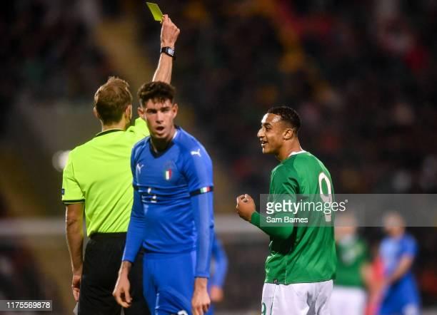 Dublin , Ireland - 10 October 2019; Adam Idah of Republic of Ireland is shown a yellow card by referee Sascha Stegemann during the UEFA European U21...