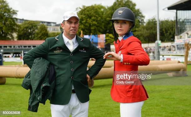 Dublin Ireland 11 August 2017 Cian O'Connor of Ireland in conversation with Lillie Keenan of USA during a walk of the course ahead of the FEI Nations...