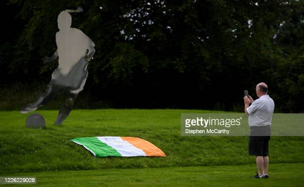 Dublin Ireland 11 July 2020 A member of the public photographs a tribute that is placed outside the FAI Headquarters in Abbotstown Dublin as a mark...