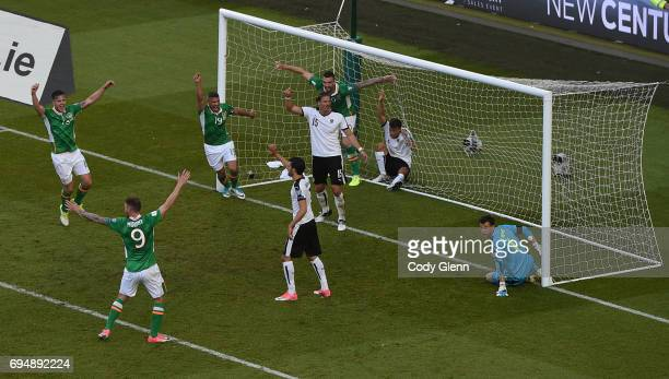 Dublin Ireland 11 June 2017 Republic of Ireland teammates from left Kevin Long Daryl Murphy Jonathan Walters and Shane Duffy react after a second...