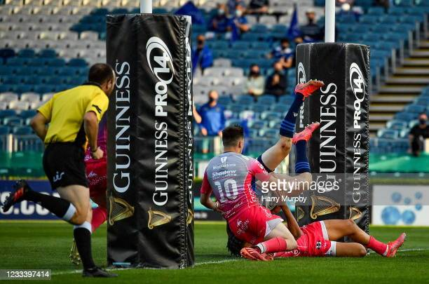 Dublin , Ireland - 11 June 2021; Garry Ringrose of Leinster on his way to scoring his side's second try despite the tackle of Rio Dyer, hidden, and...