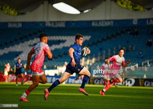 Dublin , Ireland - 11 June 2021; Garry Ringrose of Leinster on his way to scoring his side's second try during the Guinness PRO14 match between...