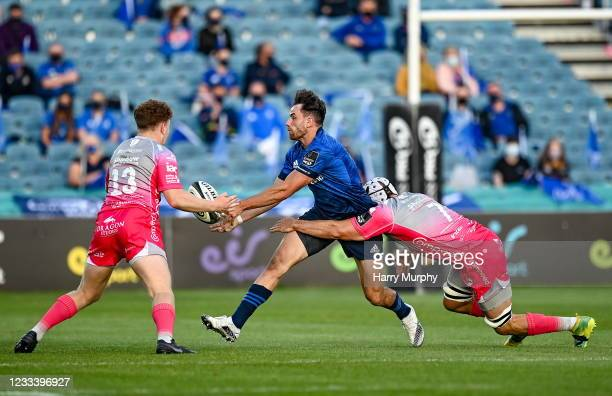 Dublin , Ireland - 11 June 2021; Hugo Keenan of Leinster is tackled by Aneurin Owen, left, and Ollie Griffiths of Dragons during the SSE Airtricity...