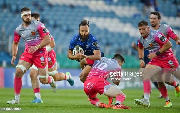 Dublin , Ireland - 11 June 2021; Jamison Gibson-Park of Leinster is tackled by Sam Davies of Dragons during the Guinness PRO14 match between Leinster...