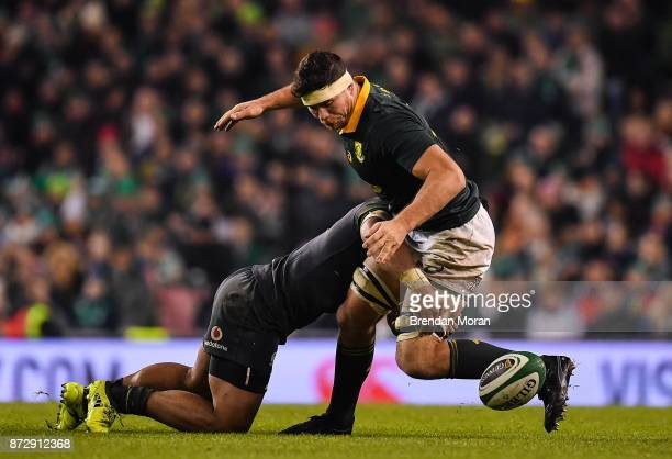 Dublin Ireland 11 November 2017 Francois Louw of South Africa loses possession in a tackle by Bundee Aki of Ireland during the Guinness Series...