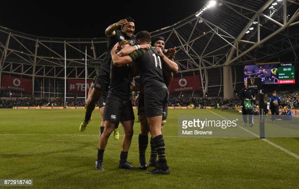 Dublin Ireland 11 November 2017 From left Bundee Aki Andrew Conway and Sean O'Brien congratulate Jacob Stockdale of Ireland after scoring his side's...