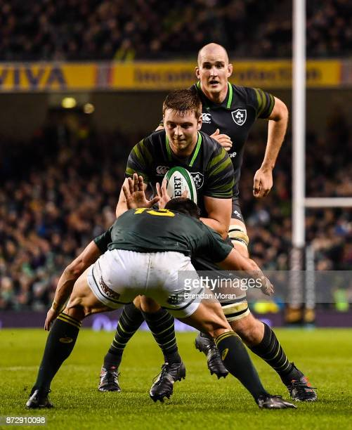 Dublin Ireland 11 November 2017 Iain Henderson of Ireland is tackled by Damian de Allende of South Africa during the Guinness Series International...