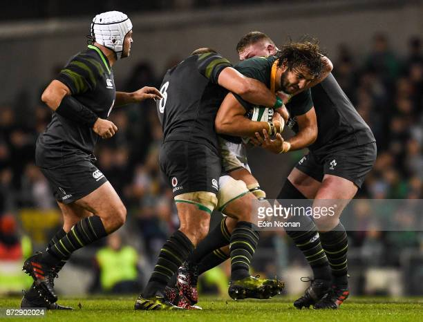 Dublin Ireland 11 November 2017 Lood de Jager of South Africa is tackled by CJ Stander left and Tadhg Furlong of Ireland during the Guinness Series...