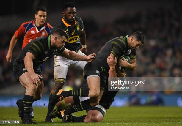 Dublin Ireland 11 November 2017 Rob Kearney of Ireland is tackled by Wilco Louw of South Africa during the Guinness Series International match...