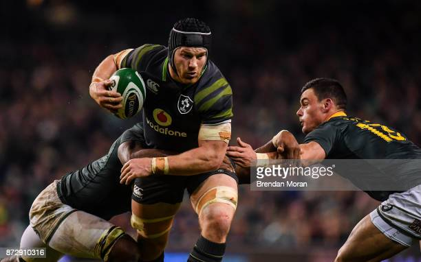 Dublin Ireland 11 November 2017 Sean O'Brien of Ireland is tackled by Siya Kolisi left and Jesse Kriel of South Africa during the Guinness Series...