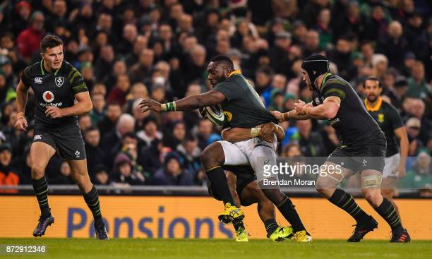 Dublin Ireland 11 November 2017 Tendai Mtawarira of South Africa is tackled by Bundee Aki and Sean O'Brien of Ireland during the Guinness Series...