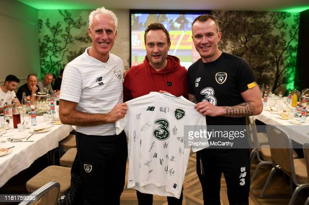 Dublin Ireland 11 November 2019 Comedian and impressionist Mario Rosenstock with Republic of Ireland manager Mick McCarthy and Glenn Whelan during a...