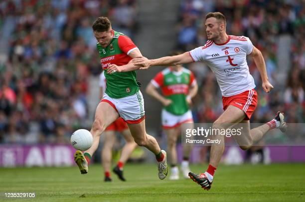 Dublin , Ireland - 11 September 2021; Matthew Ruane of Mayo in action against Brian Kennedy of Tyrone during the GAA Football All-Ireland Senior...