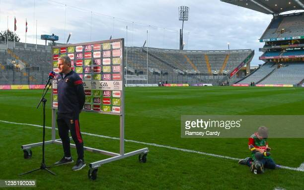 Dublin , Ireland - 11 September 2021; Mayo manager James Horan is interviewed for TV, as his son Eoghan plays on the pitch beside him, after the GAA...