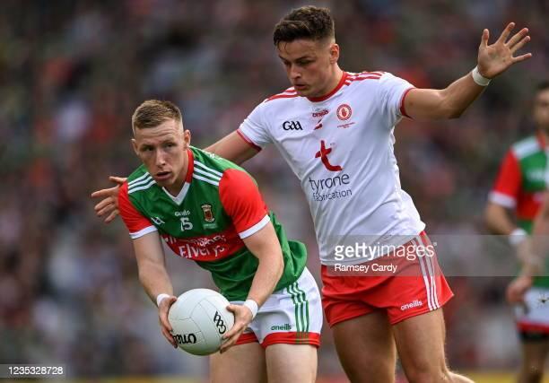 Dublin , Ireland - 11 September 2021; Ryan O'Donoghue of Mayo in action against Michael McKernan of Tyrone during the GAA Football All-Ireland Senior...