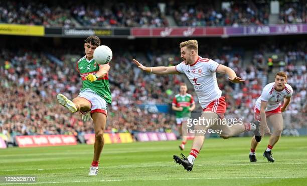Dublin , Ireland - 11 September 2021; Tommy Conroy of Mayo in action against Michael ONeill of Tyrone during the GAA Football All-Ireland Senior...